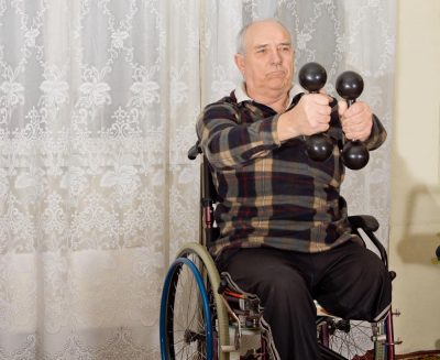 Senior handicapped man exercising to build muscle mass