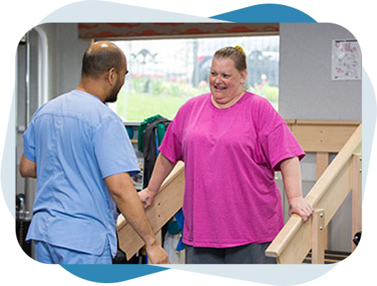 Fairview Rehab therapist helping a women with occupational therapy