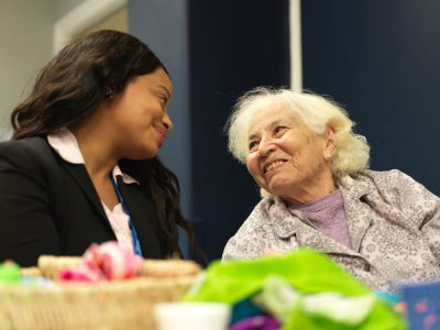Happily satisfied elderly patient with nurse at Fairview Rehab & Nursing Home