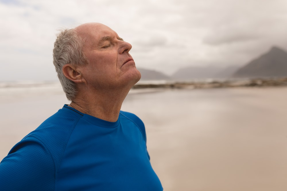 Senior man exercising and breathing fresh air to prevent asthma attacks
