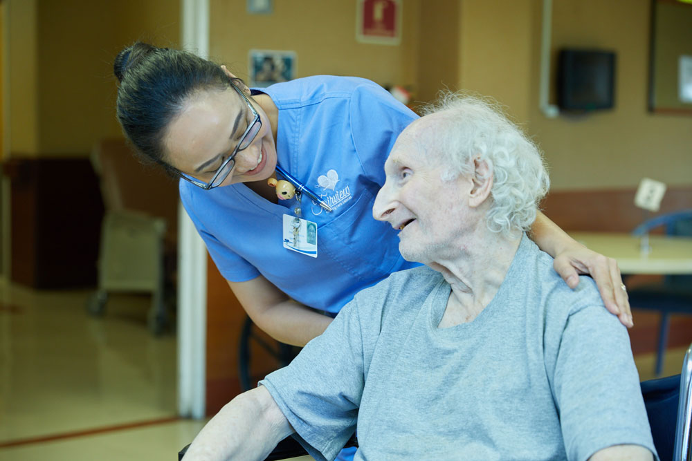 A nurse taking care of a patient suffering from vascular ulcers at Fairview Rehab & Nursing Home