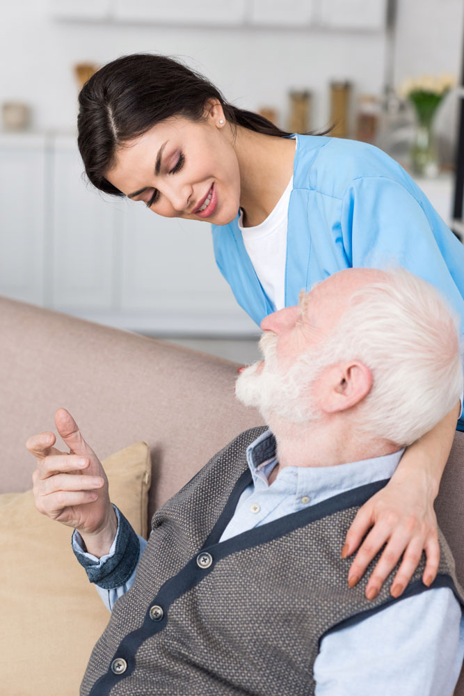 Nurse taking care of neurological diseases patient in a nursing home