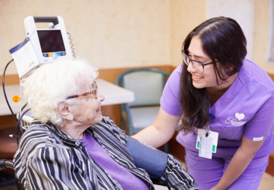 Nurse helping senior patient to recover from a heart attack