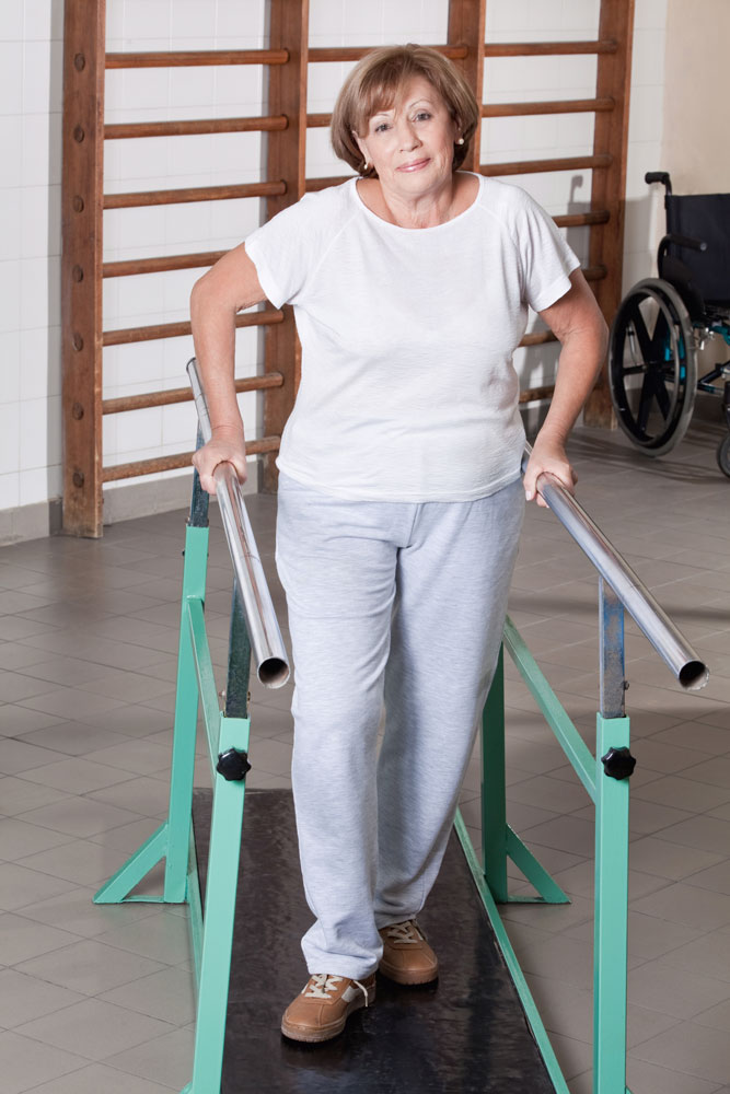 Senior woman having ambulatory therapy as a part of outpatient rehabilitation service.