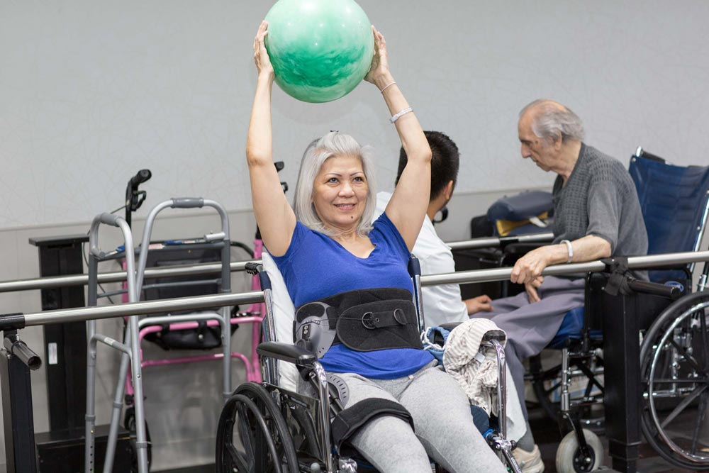 Elderly women doing exercise for cardiac rehab after bypass surgery