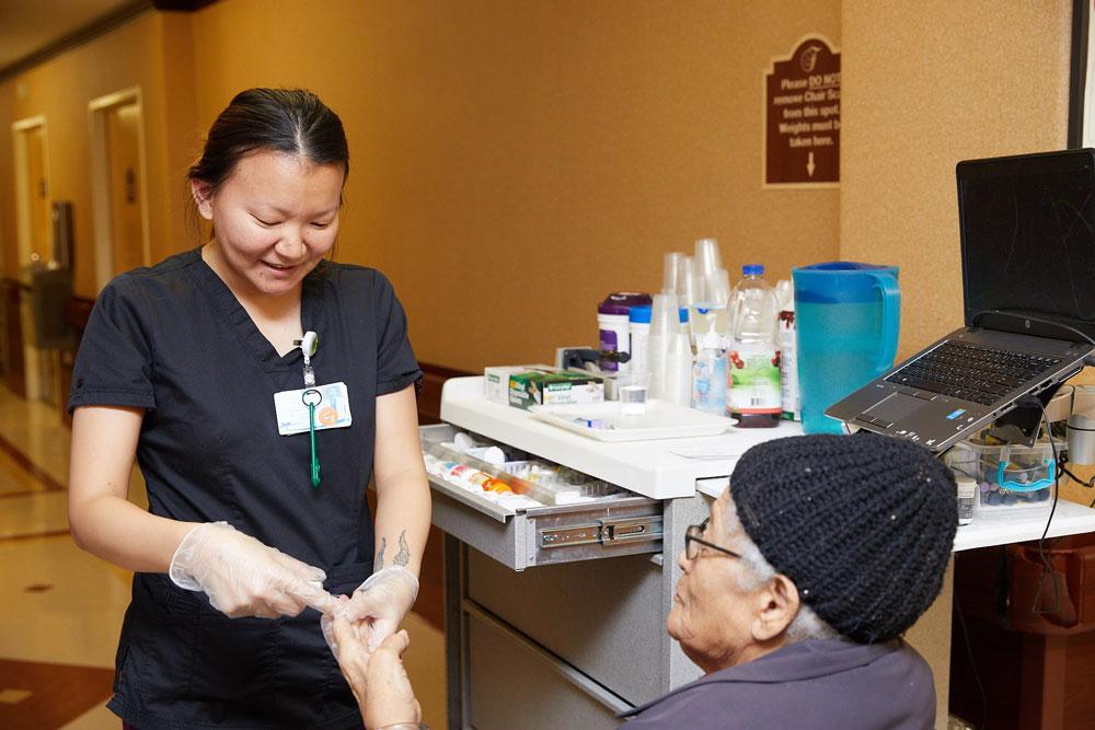 Elderly women getting nursing care to avoid pneumonia