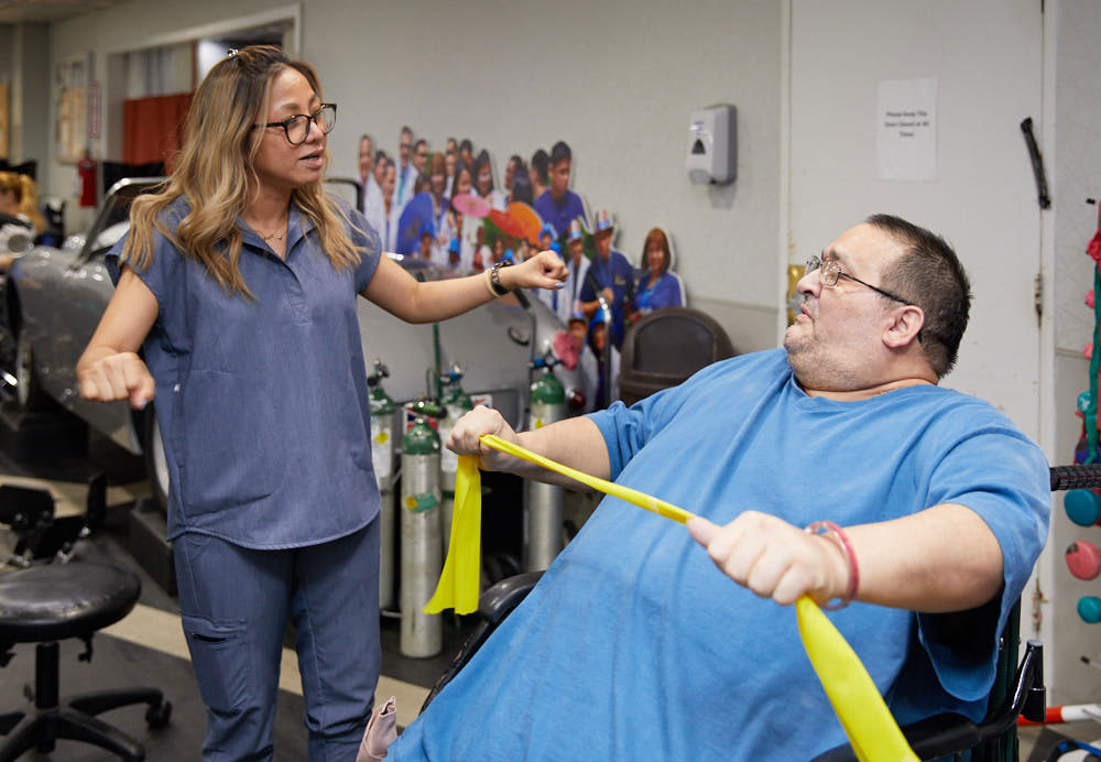 Man getting physical therapy for better healing after surgery