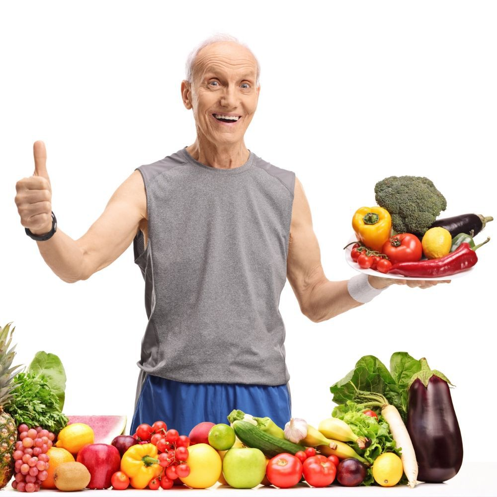Happy and healthy elderly man promoting to eat vegetables to avoid viruses