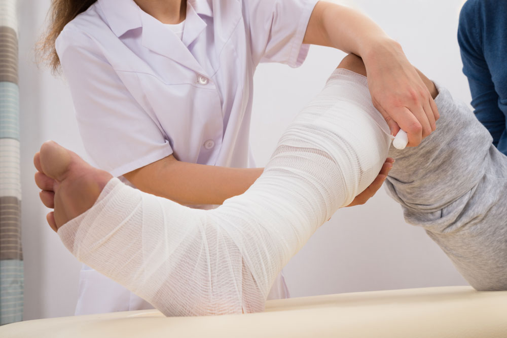 Doctor bandaging patient's leg that have diabetic wounds