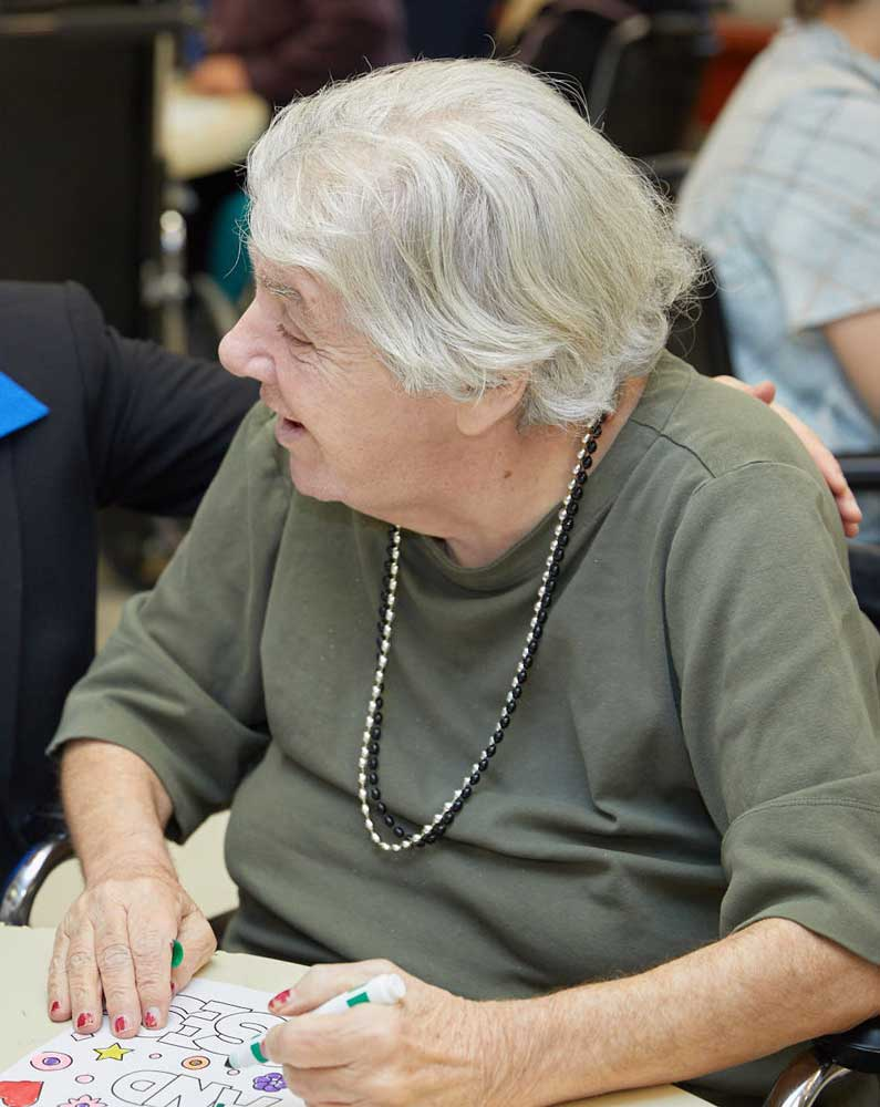Elderly women taking part in arts and crafts activities arranged at Fairview Rehab