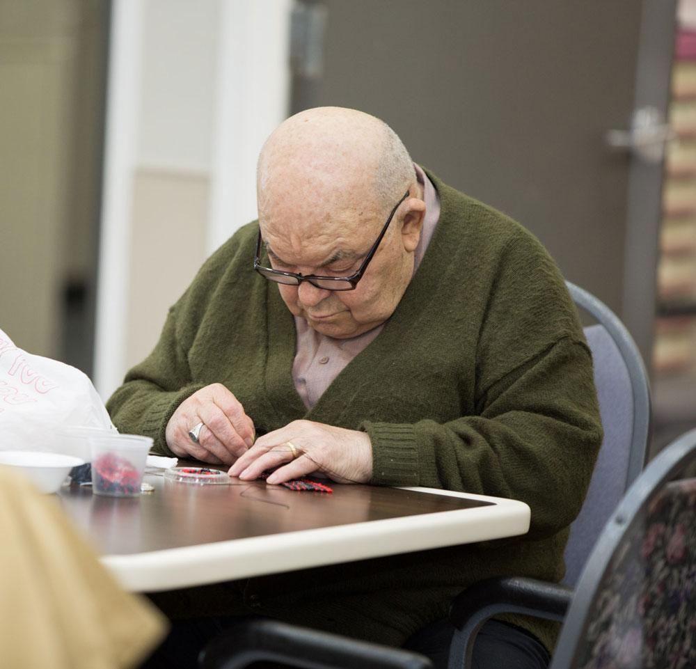 Elderly man getting occupational therapy for multiple sclerosis