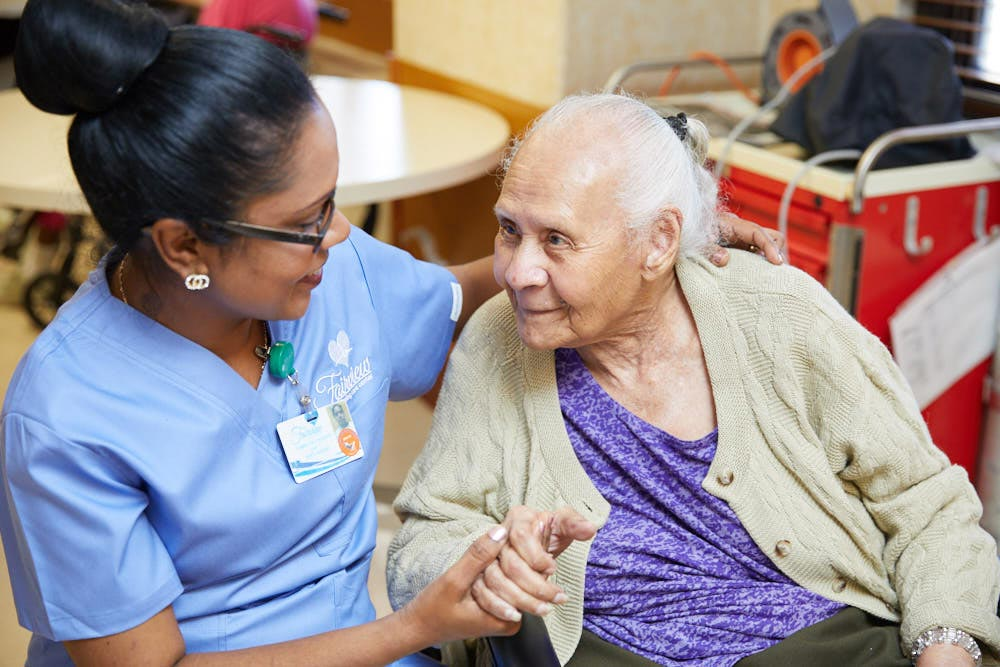 Nurse providing Neurological Rehabilitation to an elderly woman