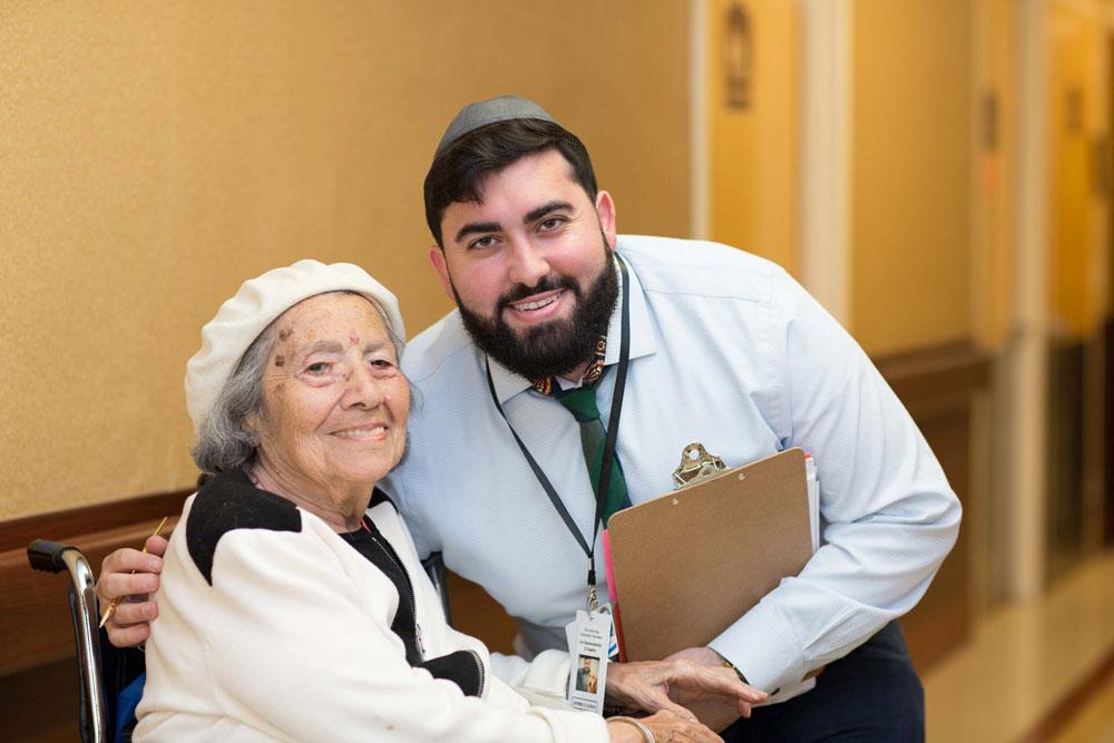 Rehabilitation staff providing compassionate care to an elderly woman